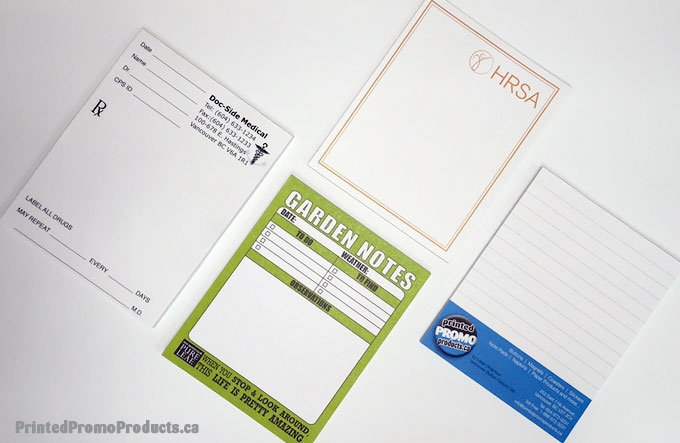 Samples of custom printed paper note pads.