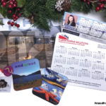 Samples of custom calendars, mouse pads, rigid fridge magnets and drink coasters for the holiday season.